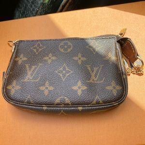 SOLD! Authentic Louis Vuitton Mini Pochette
